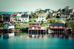 Typical Norwegian fishing village with traditional red rorbu hut Stock Photos