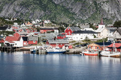 Typical Norwegian fishing village with traditional red rorbu hut Stock Images
