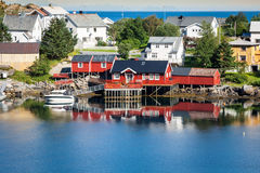 Typical Norwegian fishing village with traditional red rorbu hut Stock Image