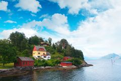 Typical norwegian landscape with red house Stock Photos