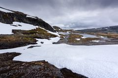 Typical norwegian landscape with snowy mountains royalty free stock photo