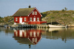 Typical Norwegian view. ARENDAL, NORWAY – CIRCA AUGUST 2006: red house is a typical example of Norwegian architecture circa August 2006 in Arendal Royalty Free Stock Images