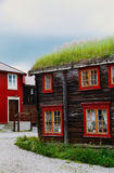 A typical norwegian wooden house with grass on the rooftop located in a traditional town of Roros, Norway. Royalty Free Stock Image