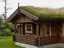 Typical Norwegian wooden mountain cabin log house with turf roof Royalty Free Stock Photos