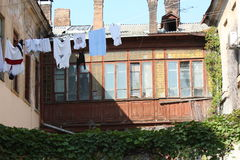 Typical Odessa patio. Old wooden windows and walls, lots of plants and lots of linen put out to dry Stock Images