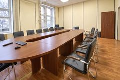 Typical office meeting room, long table and chairs. Close-up royalty free stock images