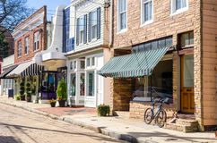 Typical Old American Stores on a Sunny Autumn Day. Typical American Stores along a Cobblestone Street  in the Historic District of Annapolis, MD, on a Sunny Royalty Free Stock Photography