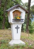Typical old Christian Wayside Shrine at a country road Stock Photo