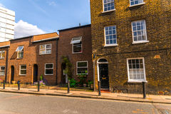 Typical old English buildings, low brick buildings across a narr Royalty Free Stock Images