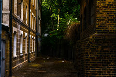 Typical old English buildings, low brick buildings across a narr Royalty Free Stock Image