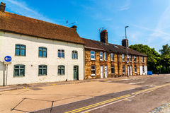 Typical old English buildings, low brick buildings across a narr Royalty Free Stock Photography