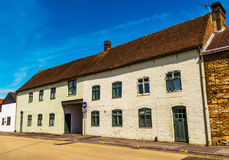 Typical old English buildings, low brick buildings across a narr Royalty Free Stock Photo