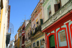 Balcony with wet clothes in Havana, Cuba. A typical old house in colonial style on central Havana, Cuba, wet clothes are drying in the wind, hanging in the Royalty Free Stock Images