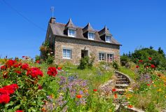 Typical old house and garden in Brittany Stock Photo