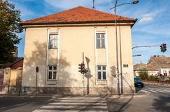 Typical old house Serbian architecture in the city of Novi Sad with traffic lights and street lamps. Novi Sad, Serbia. October - 27. 2018. Typical old house stock photography
