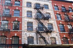 Typical old houses in Tribeca, NYC, USA. Typical old houses with facade stairs in TRibeca, NYC, USA stock photography