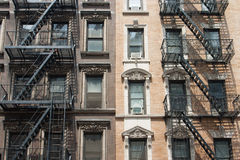 The typical old houses with fire stairs in New York Royalty Free Stock Photo