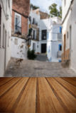 Typical old Mediterranean alley between old houses with wooden p Stock Photos