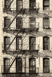 Typical old New York City building. With fire escape ladders Royalty Free Stock Images