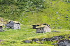 Typical old Norwegian houses near Geiranger in Geirangerfjord, Norway. Stock Photo