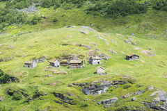 Typical old Norwegian houses near Geiranger in Geirangerfjord, Norway. Royalty Free Stock Photography