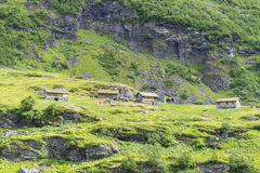 Typical old Norwegian houses near Geiranger in Geirangerfjord, Norway. Stock Photography