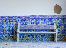 Typical old portugese blue and white tile wall decoration with tile bench Stock Photo