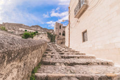 Typical old stairs view of Matera under blue sky Royalty Free Stock Images