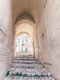 Typical old stairs view of Matera under blue sky Royalty Free Stock Photo