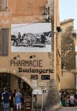 A typical old stone house with a billboard depicting the scenes of old-fashioned life in Gordes village, Vaucluse, Provence. France Stock Photos