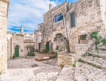 Typical old street and stairs view of Matera under blue sky Stock Images