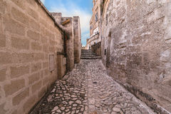 Typical old street and stairs view of Matera under blue sky Stock Photos