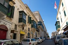 Typical, old street in Valletta, Malta. Landscape of a typical, old street in Valletta, Malta. There are traditional Maltese architecture, characterized by Royalty Free Stock Photo