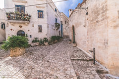 Typical old street view of Matera under blue sky Stock Photography