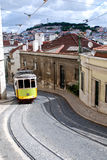 Typical old tram in a street of Lisbon. Portugal. A typical old tram in a little street of Baixa, a ancient district of Lisbon, Portugal royalty free stock image