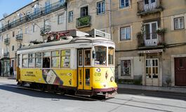 Lisbon typical tram cityscape, Portugal. Typical old tram, trams in the city Lisbon, the capital of Portugal. Typical european arcitecture of Lisbon cityscape royalty free stock photography