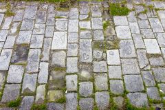 Typical old Tuscany paving made with carved stone blocks.  royalty free stock photography