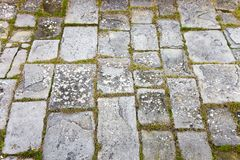 Typical old Tuscany paving made with carved stone blocks.  royalty free stock image