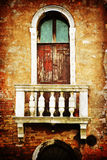 Old window with vintage style texture. Typical old window in Venice, Italy, overlaid with an attractive vintage style texture Royalty Free Stock Photos