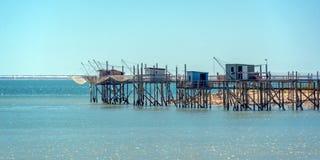 Typical old wood fishing huts on stilts in the atlantic ocean near La Rochelle, France. Typical old wooden fishing huts on stilts in the atlantic ocean near La royalty free stock photos