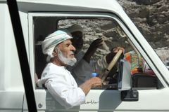 Typical Omani man driving a car Royalty Free Stock Photography