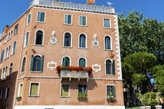 Typical orange building with antique windows in Venezia Royalty Free Stock Photography