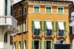 Typical orange building with antique windows in Verona Stock Image