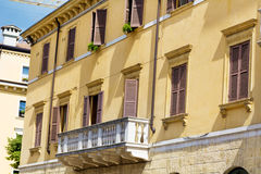 Typical orange building with antique windows in Verona Stock Photography