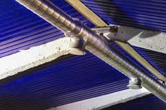 Typical outlet vent and central ventilation duct. A round galvanized steel duct connecting to a typical diffuser stock photo