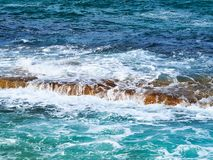Pacific Ocean waves on Bondi Rocks, Sydney, Australia. Typical pacific Ocean waves and swell crashing or washing over sandstone rocks in sea, North Bondi Beach stock photography