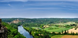 Typical panorama of the Dordogne valley in the Périgord Noir. View of the Dordogne valley from the castle of Castelnaud with the castle of Beynac and Cazenac royalty free stock photos