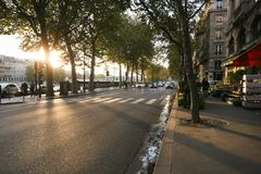 A typical Parisian street, Autumn quay of the Seine, sunset, walkway, royalty free stock image