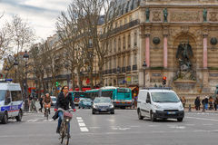 Typical Parisian street with cyclists, tourists Royalty Free Stock Photography