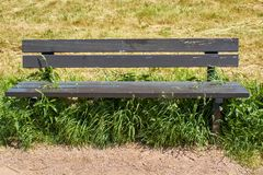 Typical park bench of the former GDR royalty free stock photo